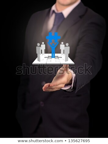 Businessman presenting human forms on jigsaw pieces  Stock photo © wavebreak_media