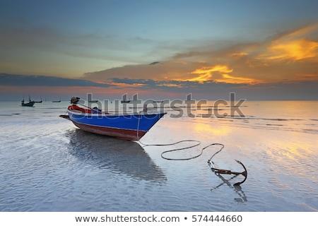 boat anchored on lake stock photo © elenaphoto