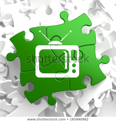 TV Set Icon on Green Puzzle. Stock photo © tashatuvango
