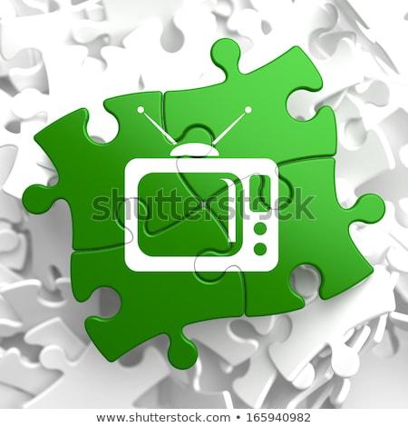tv set icon on green puzzle stock photo © tashatuvango