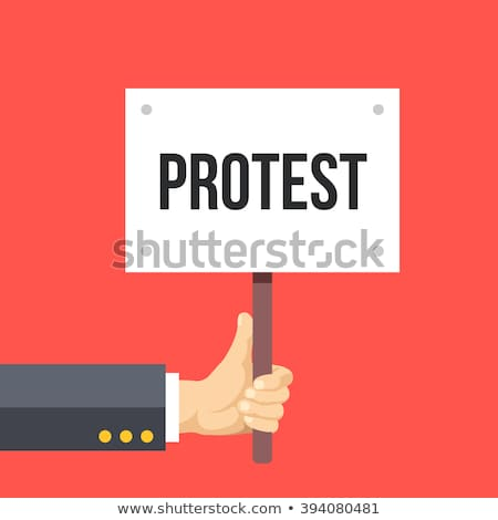 riot man holding poster with printed protest message stock photo © stevanovicigor