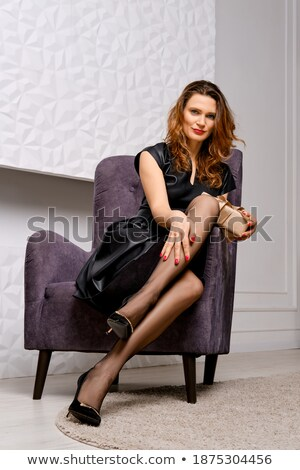 Long beautiful legs in vintage nylon stockings and high heels  Stock photo © Elisanth