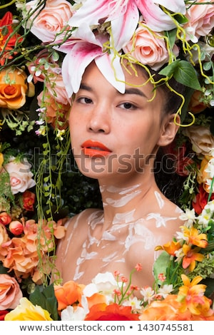 Young girl with crown and a red rose stock photo © BigKnell