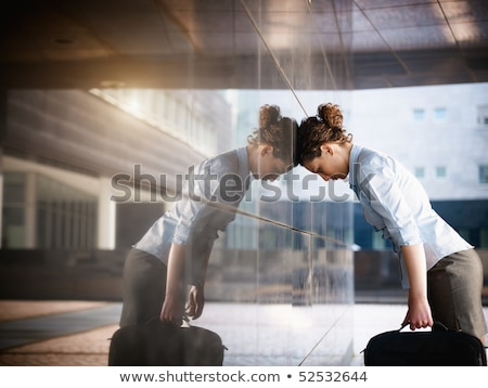 Stressed, depressed woman outisde office building Stock photo © ichiosea
