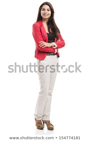 confident businesswoman standing over white stock photo © stockyimages