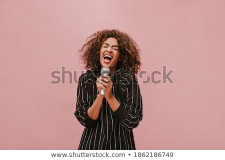 красивая женщина певицы микрофона пения громко Сток-фото © feelphotoart