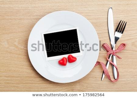 Valentine's Day blank photo frames over plate and silverware Stock photo © karandaev