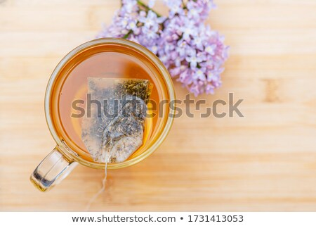 Chamomile teabag in glass mug on table Stock photo © backyardproductions