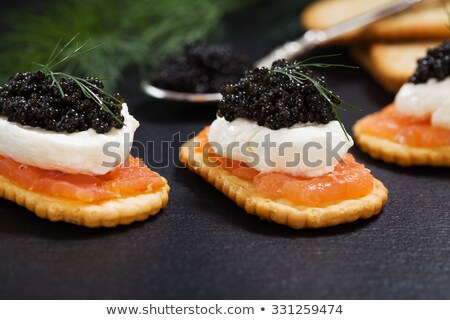 Caviar Appetizer served on crackers Stock photo © Klinker