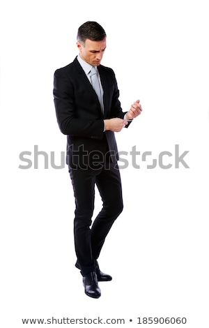 full length portrait of a businessman buttoning cuff sleeves isolated on a white background stock photo © deandrobot