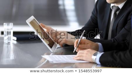 бизнесмен · Постоянный · городского · стены · молодые · портфель - Сток-фото © hasloo