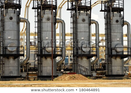 Industrial area refinery. Distillation column and pipes Stock photo © cherezoff