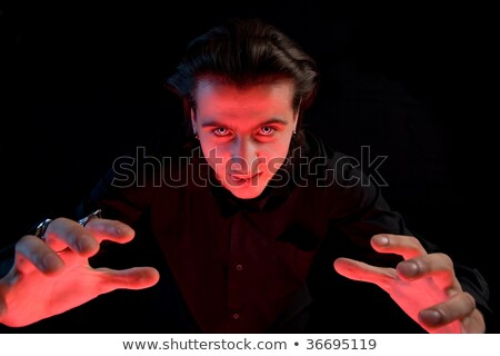 Scary vampire stretching his hands to catch a victim  Stock photo © Elisanth