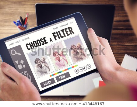 Composite image of photo editor using tablet pc Stock photo © wavebreak_media