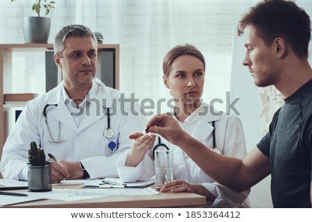 farmacêutico · olhando · câmera · farmácia · homem - foto stock © deandrobot