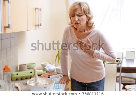 sick middle aged woman with heart attack, pain Stock photo © ichiosea
