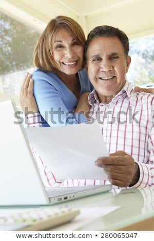 happy senior business couple smiling at the camera stock photo © ozgur