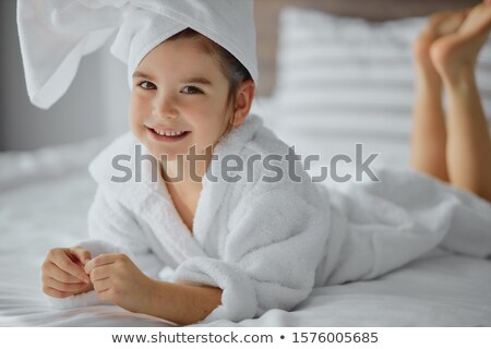 smiling beautiful woman and little girl bathes in pool stock photo © paha_l