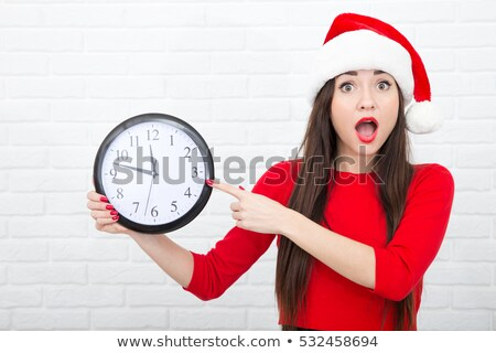 Portrait of smiling blonde female in red santa claus costume   Stock photo © deandrobot