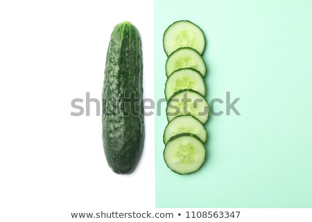 Fresh appetizing tasty cucumbers on a white background. Stock photo © mcherevan