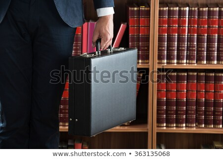 Lawyer Carrying Briefcase Against Bookshelf Stock photo © AndreyPopov