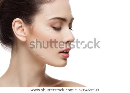 Nina base crema cara hermosa Foto stock © svetography