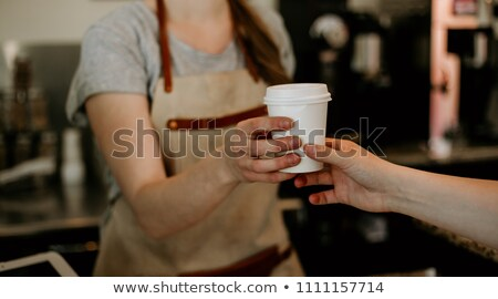 Barista serving iced black coffee Stock photo © nalinratphi