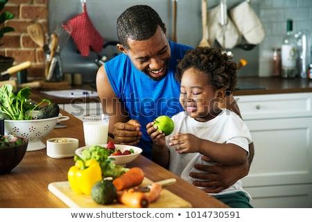 Famiglia mangiare sano colazione cucina donna bambino Foto d'archivio © wavebreak_media