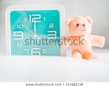 The number twelve and cheerful bear Stock photo © bedlovskaya