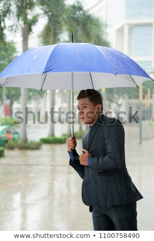 Stock photo: Businessmen in rain