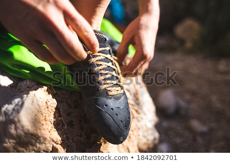 Close-up of climber putting on safety harness climbing equipment stock photo © deandrobot