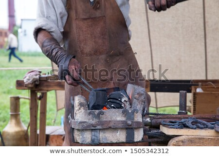 Hammer and anvil. smith tools. Accessory blacksmithing Stock photo © popaukropa