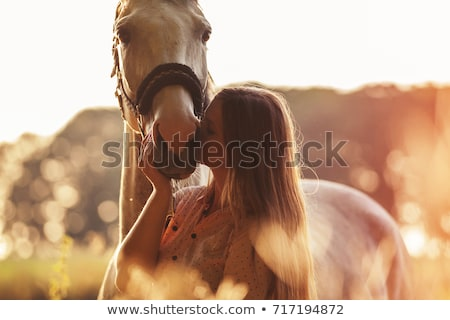 Happy lovely young woman cowgirl riding horse on ranch Stock photo © deandrobot