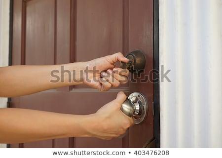 çilingir kapıyı açmak anahtar ev kapı oda Stok fotoğraf © bank215