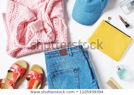 Top view of a woman wearing red lipstick and sweater Stock photo © deandrobot