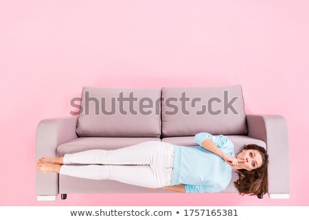 Top view of attractive woman lying and showing silence sign Stock photo © deandrobot