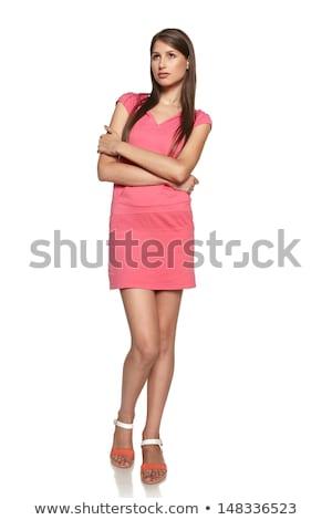 Zamyślony piękna młoda kobieta stałego ręce fałdowy Zdjęcia stock © deandrobot