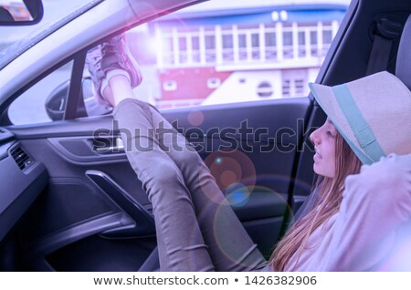 woman sitting in car passenger seat hipster teenage girl enjoyi stock photo © vlad_star