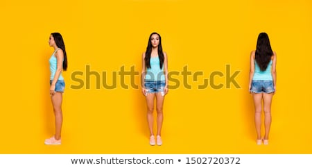 vertical image of hipster in snap back stock photo © deandrobot