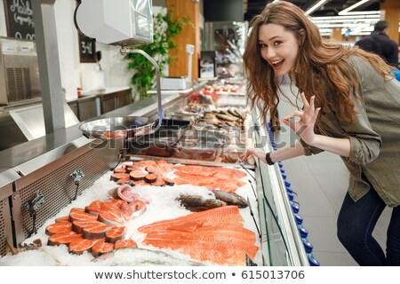 側面図 幸せ 女性 魚 カウンタ 立って ストックフォト © deandrobot