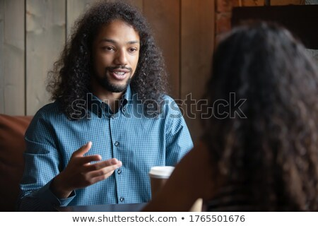 Dialogue of two pretty women sitting in cafe Stock photo © deandrobot