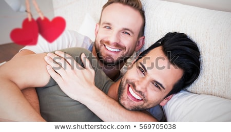 Portrait Happy Gay Couple Homosexual Men At Home Stock photo © diego_cervo