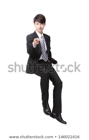 счастливым сидящий бизнесмен указывая пальцы Сток-фото © feedough