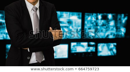 Businessman Looking At CCTV Footage On Computer Stock photo © AndreyPopov