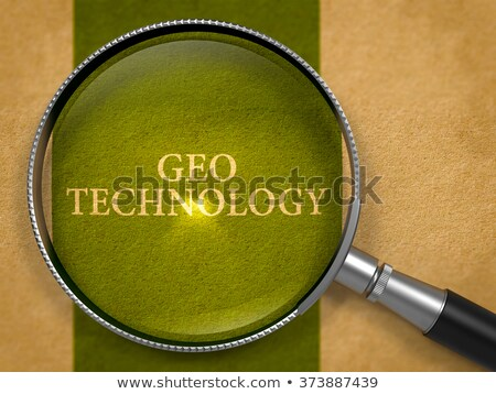 Geo Technology through Loupe on Old Paper. Stock photo © tashatuvango