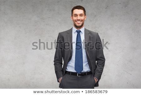 Zdjęcia stock: Człowiek · garnitur · młody · człowiek · szary