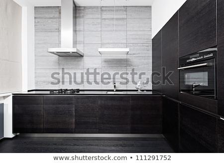 Part of white kitchen furniture Stock photo © artjazz