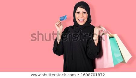 Muslim business woman holding a money bag. Stock photo © RAStudio
