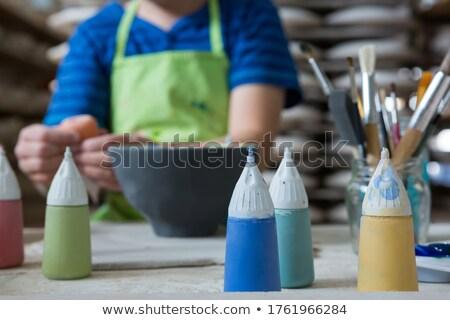 Verf jongen schilderij kom aardewerk Stockfoto © wavebreak_media