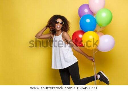 african american woman with balloons stock photo © LightFieldStudios